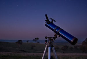 Stargazing telescope looking downward at the earth.