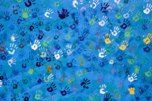 Hopeful Helping Hands - painted handprints on a wall