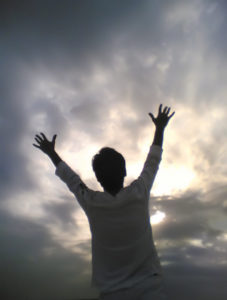 Raising one's arms to the heavens
