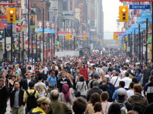 Crowds of people walking down a Toronto city street.