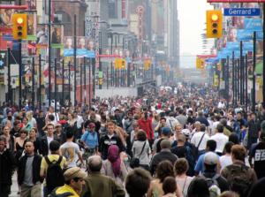 Crowds of people walking down a Toronto city street
