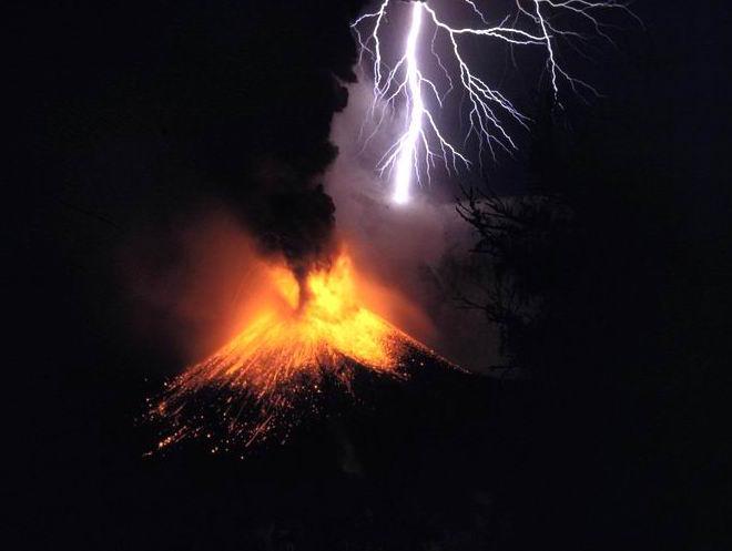 Photograph of a volcanic eruption amidst lightening