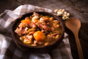 Prepared beans and beef meat in a rustic bowl