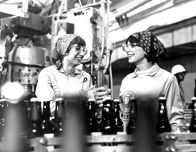 Photo of Laverne and Shirley at wok among an assembly line.