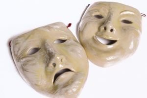 A pair of masks showing comedy & tragedy.
