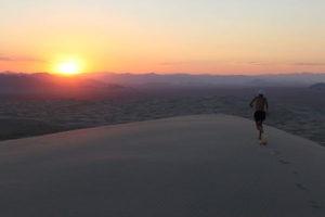 Man running in the Mojave Desert.