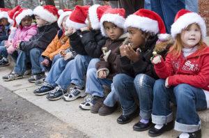 Children wearing Santa Hats.