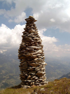 A cairn to mark a mountain summit in Graubünden, Switzerland.