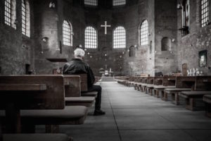 Man sitting in church alone