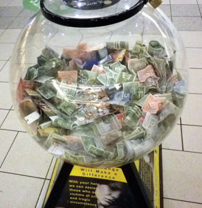 Foreign currency donations in a spherical bowl