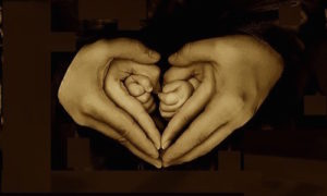 Hands surrounding each other forming hearts