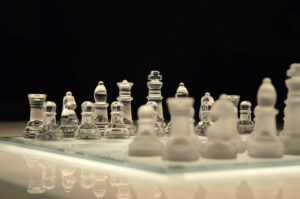 Chess pieces set up on a chessboard