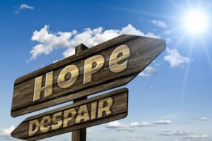 Signs pointing in opposite directions to Hope and Despair
