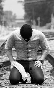 Man kneeling in humility