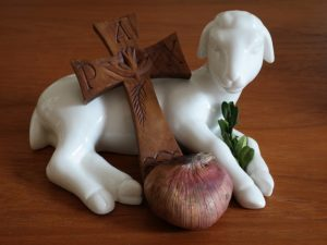 Lamb carrying a cross
