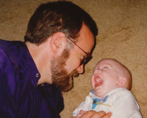 Nathan (a good bit smaller than he is today) and me (a good bit younger than I am today) wrestling on the carpet when he was a baby.