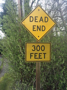 "A sign post that reads ""Dead End""."