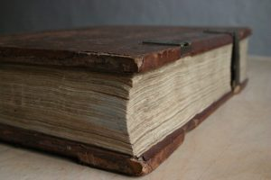 Close up of a very old volume of a book with scuff marks.