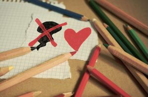 Darkness crossed out with a heart drawn in color pencil.