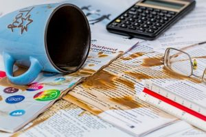 Coffee spilled on work documents.