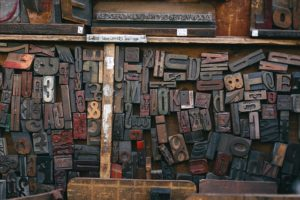 Scattered letters & numbers from a printing press in a tray.