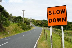 "Road sign ""slow down"""
