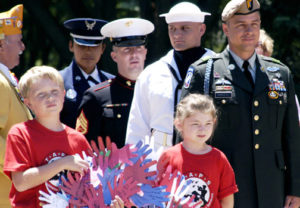 A Memorial Day event at Arlington National Cemetery, with children remembering their father's sacrifice.