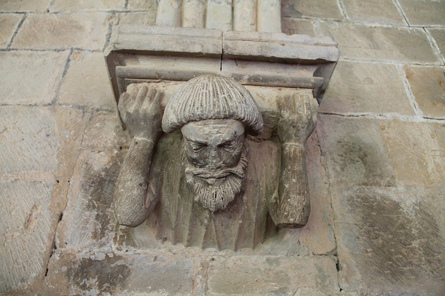 Figure with the weight from a building on his shoulders.