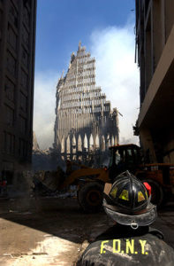 A firefighter looks on at the remains of the Twin Towers following the 9/11 terrorist attacks.