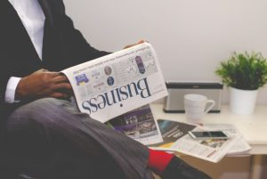 A newspaper being read in an office.