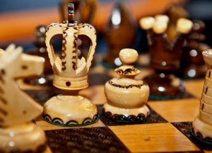 Close up of the king in a wooden chess set.