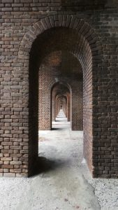 Looking down a row of fortified archways.