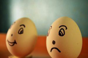 Sad egg face vs. happy egg face.