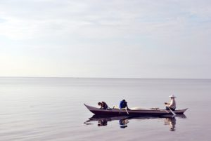People heading out on a boat to fish.