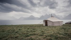 A tent erected near a body of water