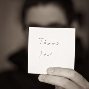 Thank you written on a Post-it note.