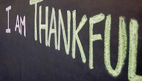 """""""I am Thankful"""" written on a chalkboard."""