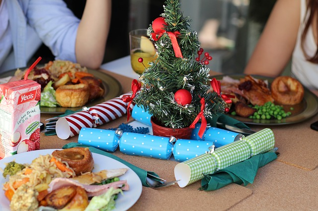 People sitting around a simple Christmas meal.