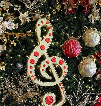 A Christmas tree ornament in the shape of a treble clef.