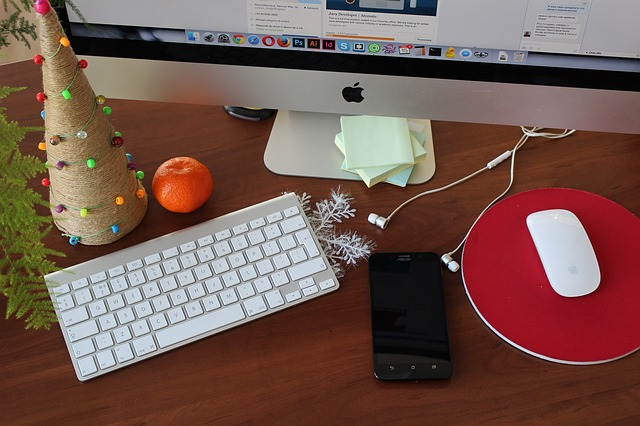 A work desk with hints of Christmas scattered on it.