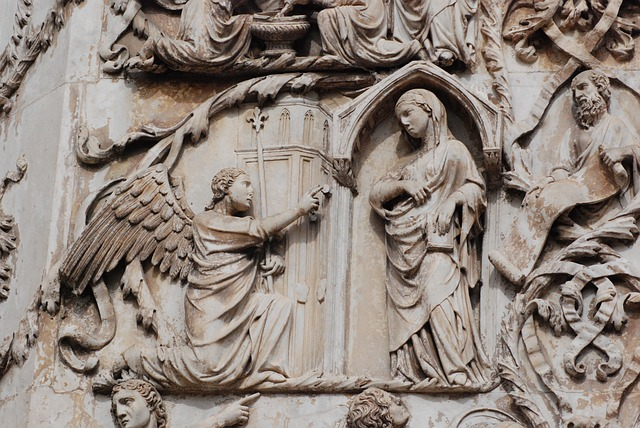The angel speaking to Mary.