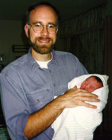 Mark Roberts holding his daughter.