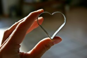 A cookie cutter in the shape of a heart.