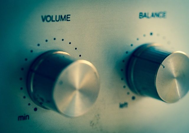 The dials for volume and balance on a stereo system.