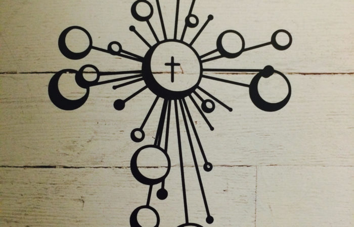 A cross with spheres of influence radiating outward.