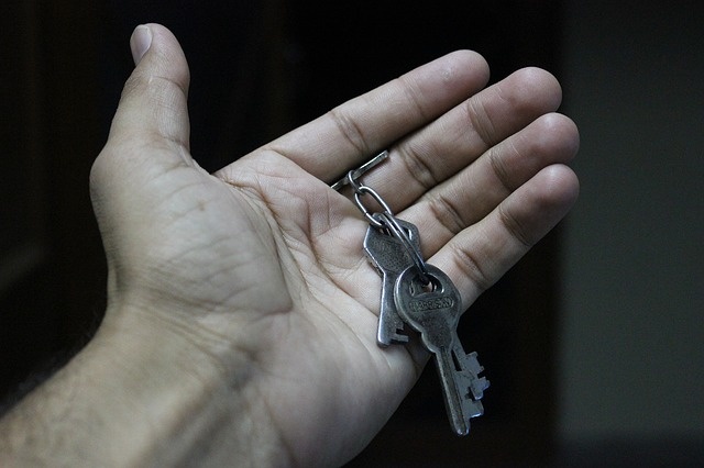 An open hand, holding a set of keys.