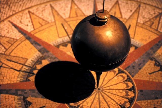 A pendulum balanced on point by gravity.