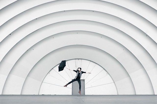 A person in motion, dancing before a backdrop that looks as if it is amplifying the movements.