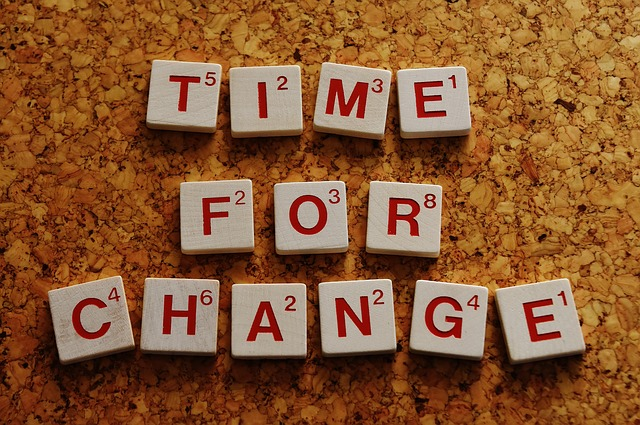 Time for Change spelled out with letter tiles.