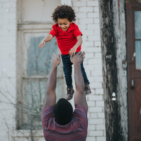 A child being caught by a Father's love.